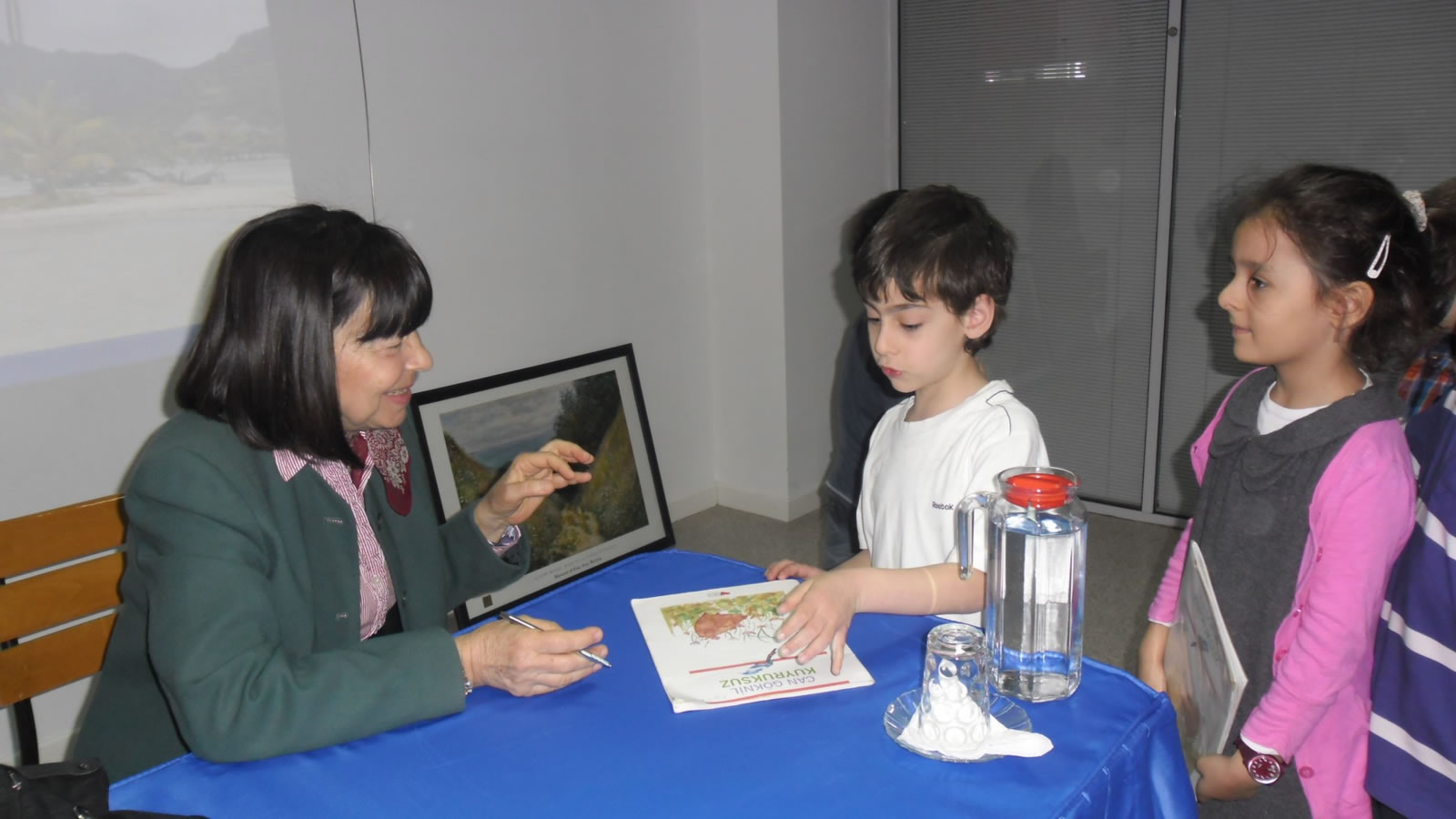 Can Göknil discussing her books with 1st graders